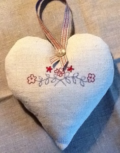 Scandinavian style heart in red and blue on vintage linen