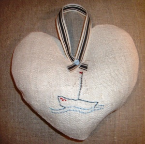 Embroidered boat on vintage linen